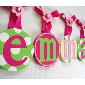 hand painted round wall letters   hot pink and green